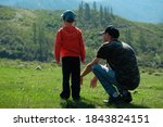 father and son sit and stand on ... | Shutterstock . vector #1843824151