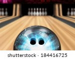 Bowling Ball is Rolling on Wooden Lane. Focus on Bowling Ball