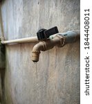 Water drop from spigot at the...