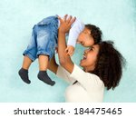 african mother playing with her ... | Shutterstock . vector #184475465