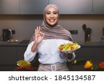 Arab Lady Cooking Standing In...