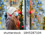 Girl wearing face mask on a...