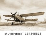 Old Airplane On Field In Sepia...