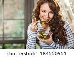 pretty woman eating fresh... | Shutterstock . vector #184550951