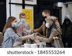 Volunteers Serving Hot Soup For ...