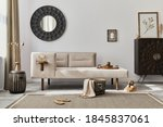 Small photo of Modern ethnic living room interior with design chaise lounge, round mirror, furniture, carpet, decoration, stool and elegant personal accessories. Template. Stylish home decor.