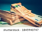 Large Pile of European Euro Currency Banknotes. Cash Money on Glassy Office Table. Business and Economy Theme. - stock photo
