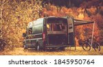 Scenic Recreational Vehicle RV Camping Spot with Fall Foliage Scenery. Class B Motorhome Boondocking in the Remote Place. Outdoor and Recreation Theme. - stock photo