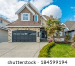 luxury house at sunny day in... | Shutterstock . vector #184599194