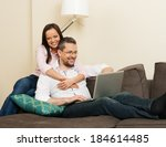 young cheerful couple with... | Shutterstock . vector #184614485
