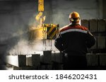 A male worker controls the...