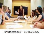 female boss addressing meeting... | Shutterstock . vector #184629227