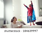 mother looking at little... | Shutterstock . vector #184639997