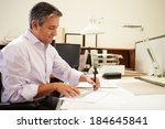 male architect working at desk... | Shutterstock . vector #184645841
