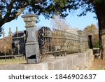 A Wrought Iron Corner Post And...