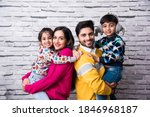 Asian Indian Young Family Wears ...