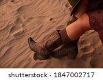 Woman Riding High Cowboy Boots...