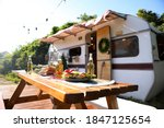Wooden Table With Food And...