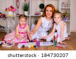 happy mother with two children... | Shutterstock . vector #184730207