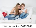 teenagers sitting on a white... | Shutterstock . vector #184756841