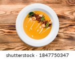 Pumpkin Soup In White Plate On...