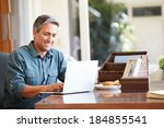mature hispanic man using... | Shutterstock . vector #184855541