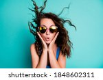 Small photo of Photo of amazed astonished speechless funky lady model palms face pink specs blast bang hairdo crazy news discount low prices seasonal sale wear blue swimsuit isolated teal color background