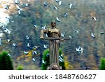 Small photo of YEREVAN,ARMENIA - OCTOBER 26,2012:Tourist's visiting main Yerevan landmark - Mother Armenia Statue or Mayr hayastan. Monument located in Victory Park, Yerevan city, Armenia.