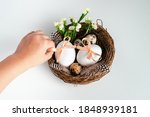Child Holding Easter Eggs And...