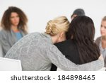 women embracing in rehab group... | Shutterstock . vector #184898465