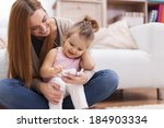 happy family with contemporary... | Shutterstock . vector #184903334