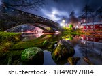 Small photo of River bridge in night city. Bridge over river. River bridge night scene
