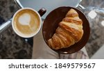 croissant and a cup of... | Shutterstock . vector #1849579567