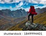 Woman Standing On Rocks Looking ...