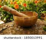 Singing Bowl Set On A Rock With ...