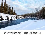 River flowing near Cameron river falls in the winter time,