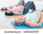 happy pregnant women in yoga...   Shutterstock . vector #185020559