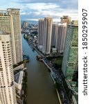 Small photo of Makati, Metro Manila, Philippines - Nov 2020: Upscale residential towers of Rockwell line the Pasig River, a major waterway in the city.