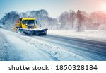 Snow Plow Truck Clearing Snowy...