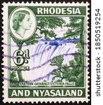 Small photo of Milan, Italy - November 11, 2014: Victoria falls on old postage stamp of Rhodesia