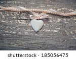 Porcelain Heart On Wooden...