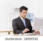 serious businessman typing on... | Shutterstock . vector #18509533