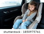 Little Girl Is Driving In Car....