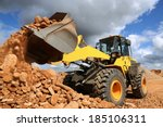 Front End Loader Dumping Stone...