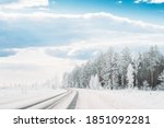 Small photo of Snow Covered Pine Forest Near Countryside Road. Frosted Trees Frozen Trunks Woods In Winter Snowy Coniferous Forest Landscape Near Country Road. Altered Sky. Adverse Weather Conditions.