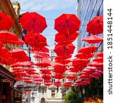 Many Open Red Umbrellas Are...