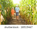 Two Children Entering A Corn...