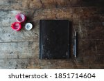 Journal On A Wooden Table In A...