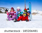 group of smiling snowboarders | Shutterstock . vector #185206481