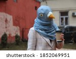 A Person In A Pigeon Mask And A ...